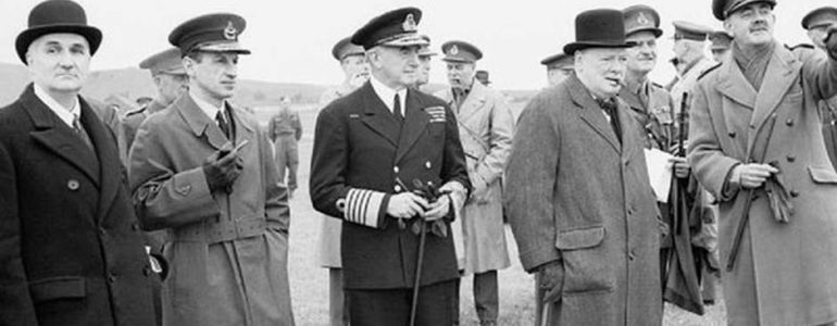 Lindemann (left) and Churchill (second from right)