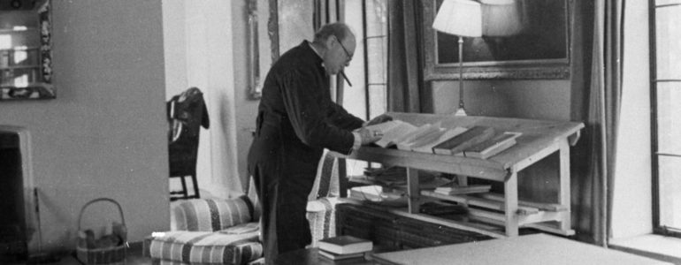 Churchill writing at his desk