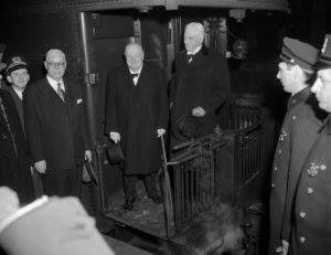 With Baruch as Churchill arrives at Grand Central Station, New York, 19 January 1952, after Churchill's third speech to Congress in Washington. (Associated Press)