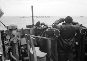 Officers on the bridge of a destroyer escorting a large convoy looking for attacking U-boats submarines during the Battle of the Atlantic. October 1941. (Wikimedia Commons)