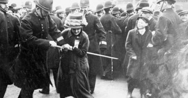 Black Friday, 18 November 1910: A policeman attempts to seize the banner pole of a suffrage demonstrator. (Daily Mirror, Wikimedia Commons)