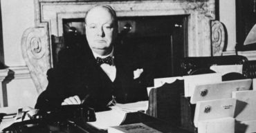 """Churchill in the Cabinet Room, 10 Downing Street, a photograph taken by Cecil Beaton on the morning of 20 November 1940. (From """"Winston S. Churchill,"""" vol. 6, Hillsdale College Press)"""
